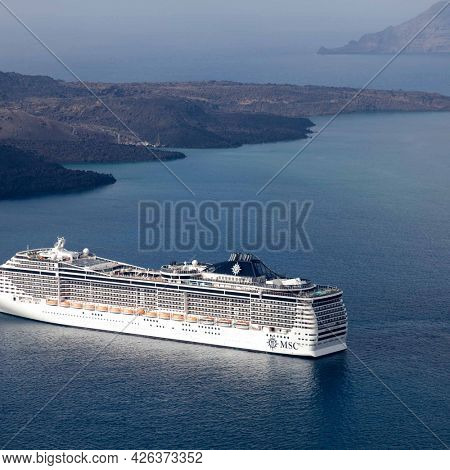 SANTORINI, GREECE-AUGUST, 20, 2014: MSC Fantasia cruise ship near Santorini island in Aegean sea. MSC Fantasia is the largest cruise ship ever built for a European ship owner. It has 1637 staterooms.