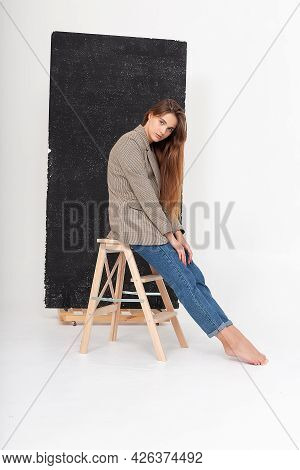 Portrait Of Young Attractive Caucasian Woman With Long Brown Hair In Suit Jacket. Skinny Pretty Lady