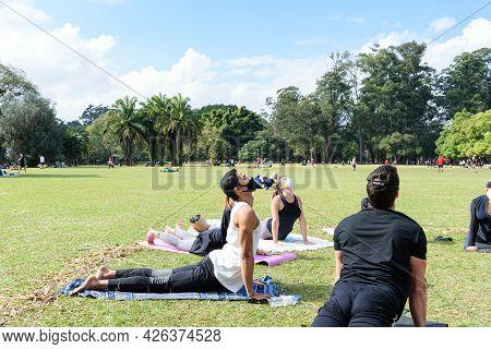 Sao Paulo, Sao Paulo, Brazil. July, 04 2021. 28 Year Old Brazilian Young Man Giving Group Yoga Class