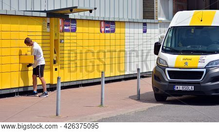 Warsaw, Poland. 9 July 2021. Courier Inpost Deliver Parcel To Automated Self Service Terminal Machin