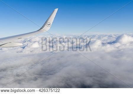 22.05.2021 Frankfurt, Germany: The Airbus A321 Wing With Lufthansa Airline Logo And Blue Sky Over Cl