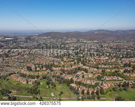 Aerial View Of Residential Neighborhood Surrounded By Golf And Valley During Sunny Day In Rancho Ber