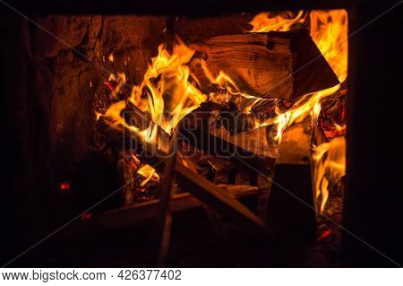 Burning Logs In The Oven. Flame In The Fireplace. Cozy Home Hearth