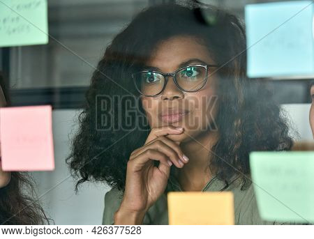 Young Thoughtful African American Girl Student Employee Leader At Modern Office University Campus Lo