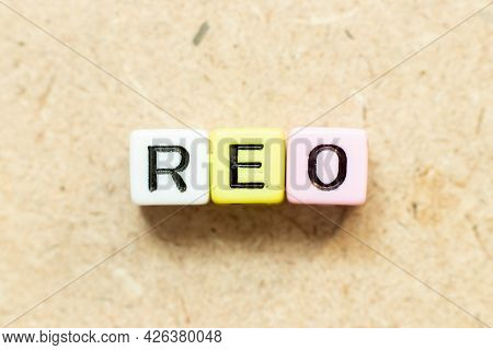 Color Alphabet Letter Block In Word Reo (abbreviation Of Real Estate Owned) On Wood Background
