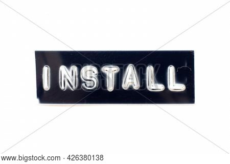 Embossed Letter In Word Install On Black Banner With White Background