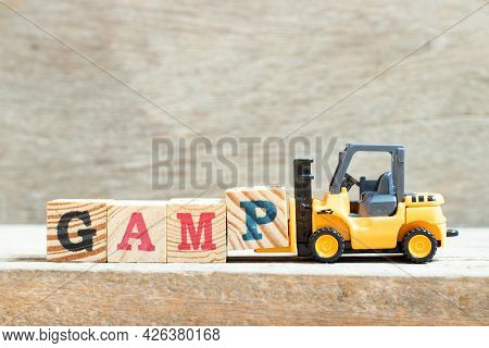 Toy Forklift Hold Letter Block P In Word Gamp (abbreviation Of Good Automated Manufacturing Practice