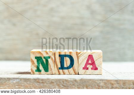 Alphabet Letter Block In Word Nda (abbreviation Of Non Disclosure Agreement) On Wood Background