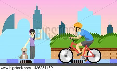 The Man Cycling Met A Friend Who Was Leasing Her Dog And She Is Listening To Music In The Park In Th