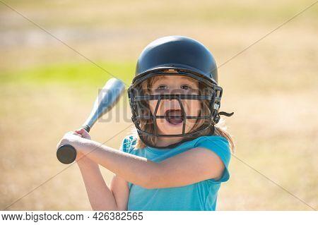 Portrait Of Excited Amazed Kid Baseball Player Wearing Helmet And Hold Baseball Bat. Funny Kids Spor