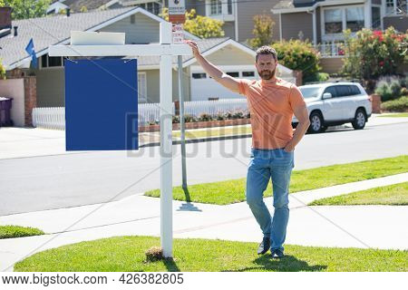 Business Man Realtor Real Estate Agent With House For Sale Sign Standing Near Residential Property O