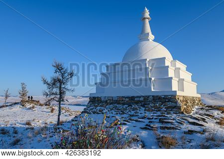 An Iconic White Buddhist Stupa On Small Sacred Hill In Lake Baikal, Russia. Tibetan Buddhism Penetra