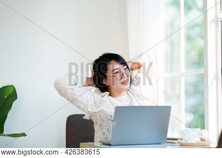 Happy Stretching Relaxation Resting Of Asian Freelance People Business Female Casual Working With La