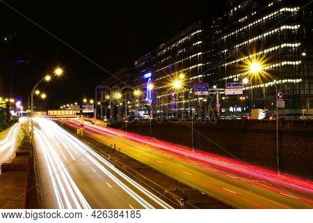 Paris, France. July 10. 2021. Cars Driving At Night On The Paris Ring Road. Spun With Headlights At