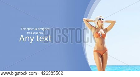 Young and beautiful blond woman posing in bikini on the beach. Fit and sexy fashion model in swimsuit.