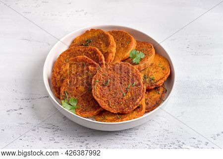 Lentil Fritters With Greens In A White Plate On A Light Blue Textured Background. Healthy Vegan Food