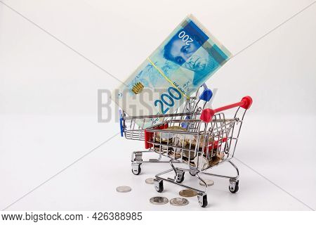 A Bundle Of 200 New Israeli Shekels Bills On A Grocery Cart And Israeli Coins On A Grocery Cart Agai