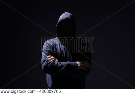 Silhouette Of Anonymous Man On Black Background