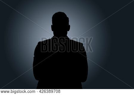 Silhouette Of Anonymous Man On Dark Background