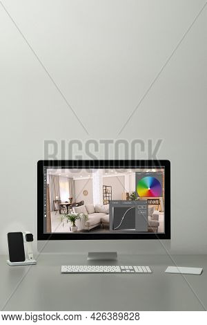 Designer's Workplace. Computer With Photo Editor Application On Table