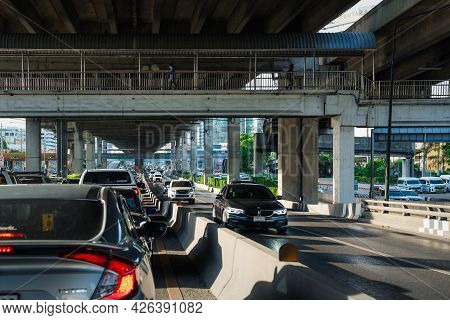 Cars On Busy Road In The City With Traffic Jam