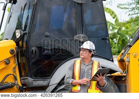 Man Construction Engineer At Construction Site