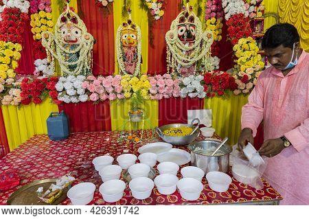 Howrah, West Bengal, India - 29th June 2020 : Vog, Prasad, Or Sacred Worshipped Food, Being Distribu