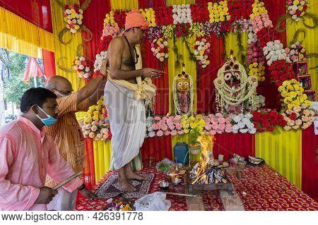 Howrah, West Bengal, India - 29th June 2020 : Hindu Devotees Worshipping Idol Of God Jagannath, Bala