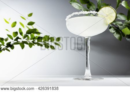 Cold Fresh Bright Sour Muddy Alcohol Cocktail With Salt Rim Decorated Slice Lime In Elegant Glass Go
