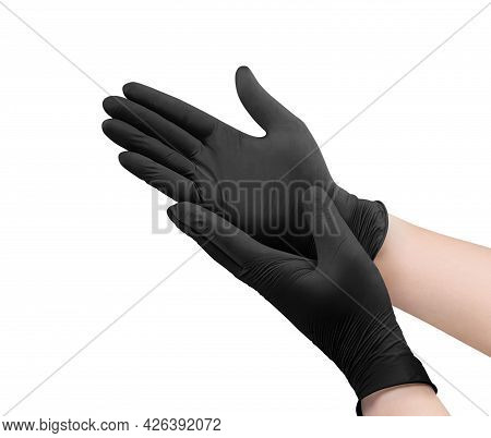Two Black Surgical Medical Gloves Isolated On White Background With Hands. Rubber Glove Manufacturin