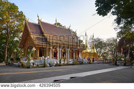 Chiang Rai Province, Thailand - February 18, 2019: Wat Phrathat Doi Tung With Two Golden Stupas At T