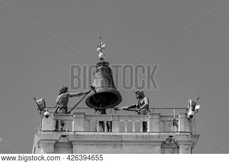Venice, Clock And Bell Tower In Renaissance Style In San Marco Square With The Statues Called Mori D