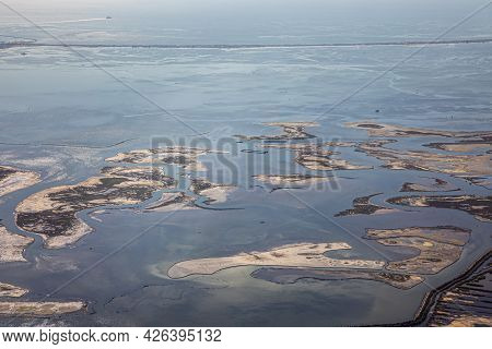 Overflying The Lagoon Of Venice With Swamp Area And Small Islands In Early Morning Light
