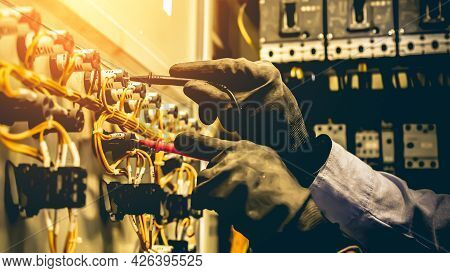 Electricity And Electrical Maintenance Service, Engineer Use Meter Checking Electric Current Voltage