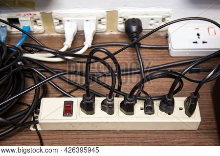 Old And Damaged Electric Adapter Power Plug Has Many Appliances Are Plugged Outlet Socket Concept Of