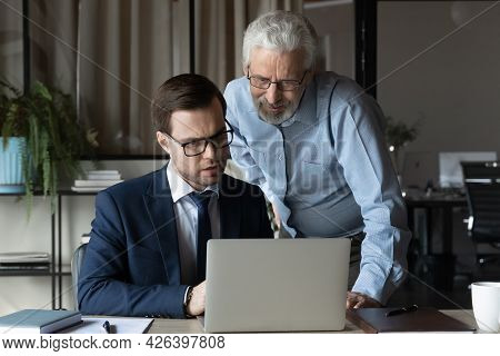 Older Professional Giving Help, Advice To Young Coworker