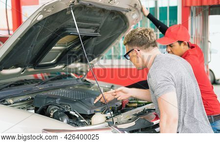 White Caucasian Car Owner Looking At Main Auto Car Engine After Filling High Energy Power Fuel In Au