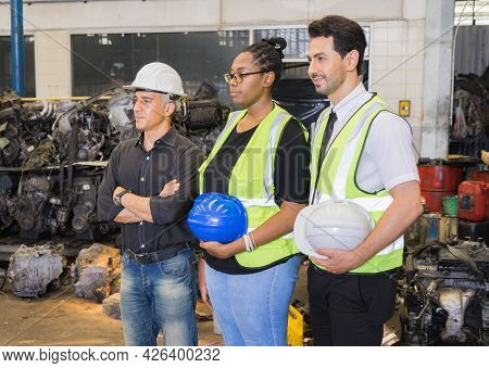 Men And Woman Work Together, Holding Helmets And Looking At Left Side. Caucasian Engineer Manager Me