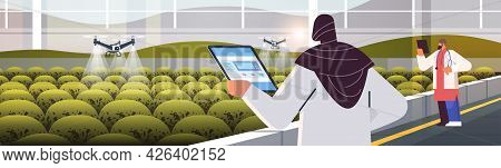 Engineers Controlling Agricultural Drones Sprayers Quad Copters Flying To Spray Chemical Fertilizers