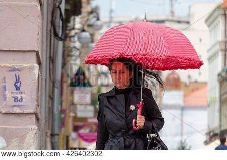 Timisoara, Romania - May 03, 2016: Woman With Umbrella Walking On The Street. Real People.