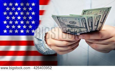 American Dollars In Hands. Coronavirus Economic Impact Stimulus Payments Or Irs Tax Refund