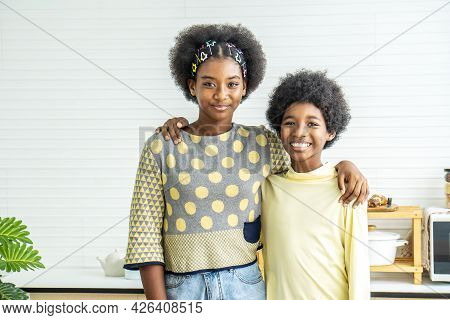 Happy Kids.two Cute Adorable Siblings African American Children Hug The Neck And Smile, Older Sister