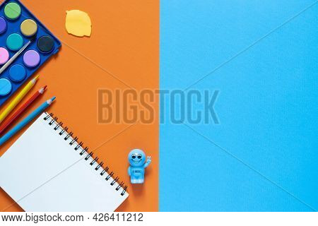 Back To School Concept. School And Office Supplies On The Office Table. 2 Color Background.flat Lay