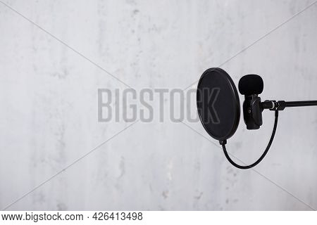 Podcast, Sound Recording And Blogging Concept - Microphone And Pop Filter Over Grey Background With