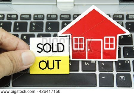 The Concept Of Real Estate, Houses And Blocks Is Colored With The Word Sold Out