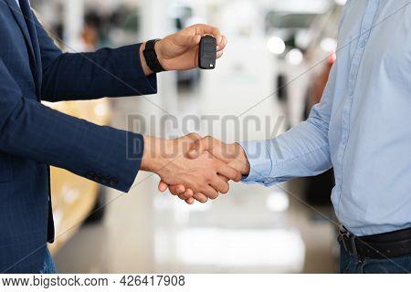 Closeup Of Customer And Car Dealer Shaking Hands