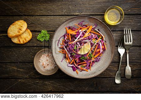 Fresh Coleslaw Salad Made Of Shredded Red And White Cabbage And Carrots On Dark Wooden Background, T