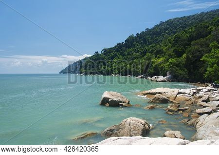 The Rocky Coast Within The Penang National Park On The Straits Of Malacca In Malaysia On A Sunny Day