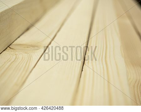 Close-up Planed Boards Lying In A Pile. Side View, Lumber For Construction. Selective Focus
