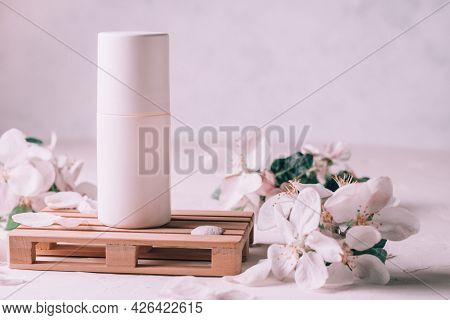 Antiperspirant Roll-on Deodorant On Wooden Podium In Form Of Pallet On Light Plaster Surface With Ap